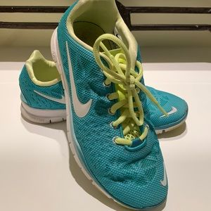 Nike Free women's athletic shoes size US 6. Turquoise and yellow